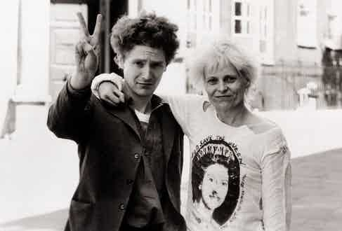 Malcolm McLaren and Vivienne Westwood wearing one of her iconic 'God Save the Queen' T-shirts in 1976.
