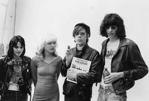 Joan Jett, Debbie Harry, David Johansen and Joey Ramone pose at a punk wedding, 1970. Photo by Roberta Bayley/Redferns/Getty Images.