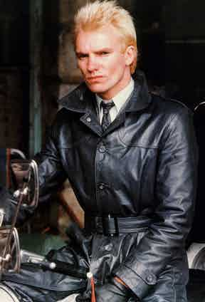 Uber mod 'Ace Face' played by Sting stands out from the others replacing a green parka with a full length black leather coat. Photo by Moviestore/REX/Shutterstock.