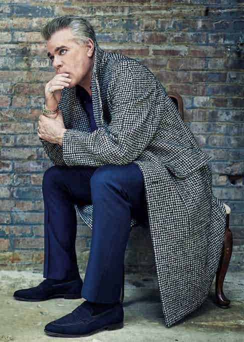 Black and white houndstooth, wool-mix oversized coat, AMI at Harrods; navy wool trousers, Gieves & Hawkes; navy linen shirt, Anderson & Sheppard Haberdashery; white-gold and stainless steel Datejust 41 with blue dial, Rolex; navy suede loafers, Crockett & Jones.  Black cotton T-shirt, property of Ray Liotta.
