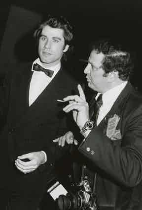John Travlota and Ron Galella in 1990. Photo by The LIFE Picture Collection/Getty Images.