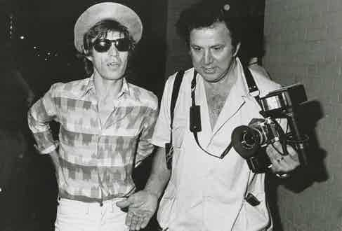 Mick Jagger and Ron Galella, circa 1982. Photo by The LIFE Picture Collection/Getty Images.