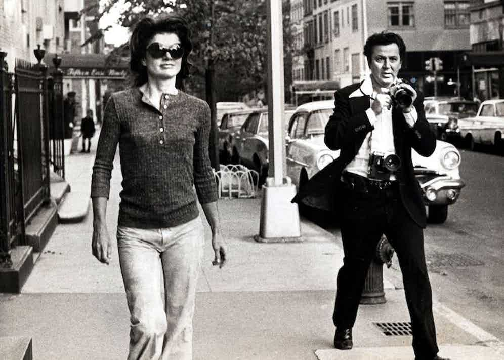 Ron pursuing Jackie Kennedy Onassis down Madison Avenue, New York, 1971. Photo by Got The Shot Prods./Kobal/REX/Shutterstock.