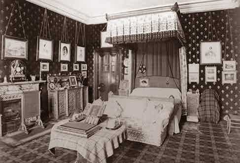 Queen Victoria's tartan-heavy bedroom in Balmoral, circa 1880. Rooms in the royal residence featured tartan wallpaper, curtains, carpets and upholstery.