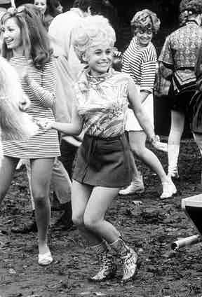 Barbara Windsor exhumes '60s style with cowboy boots and mini skirt in Carry On Camping, 1969. Photo by REX/Shutterstock.