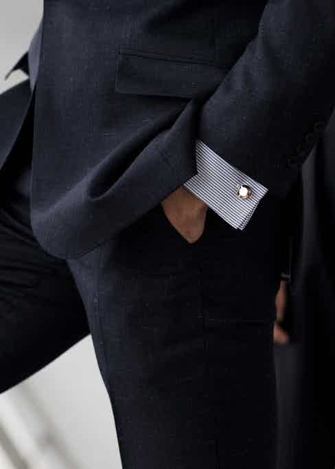 The Oliver cufflinks by Alice Made This have a diamond-pattern knurling around the edge.