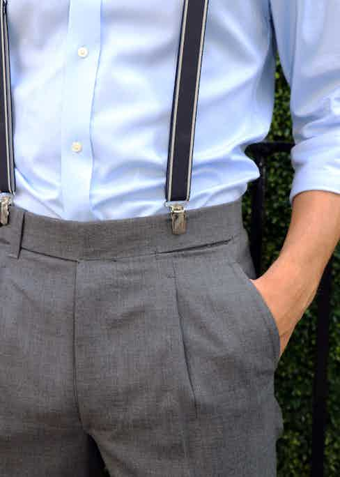 Ambrosi's grey single-pleated trousers with Albert Thurston's navy and cream clip-on braces.