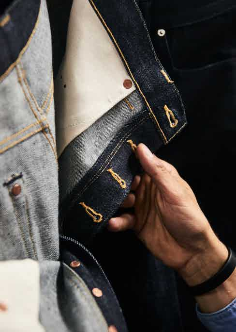 This pair of E8s are made from 14oz raw denim by Kurabo Mills, which feature a black selvedge line, in the spirit of the atelier. Notice also the hidden rivets which are there to reinforce the back pockets. Photo by Kim Lang.