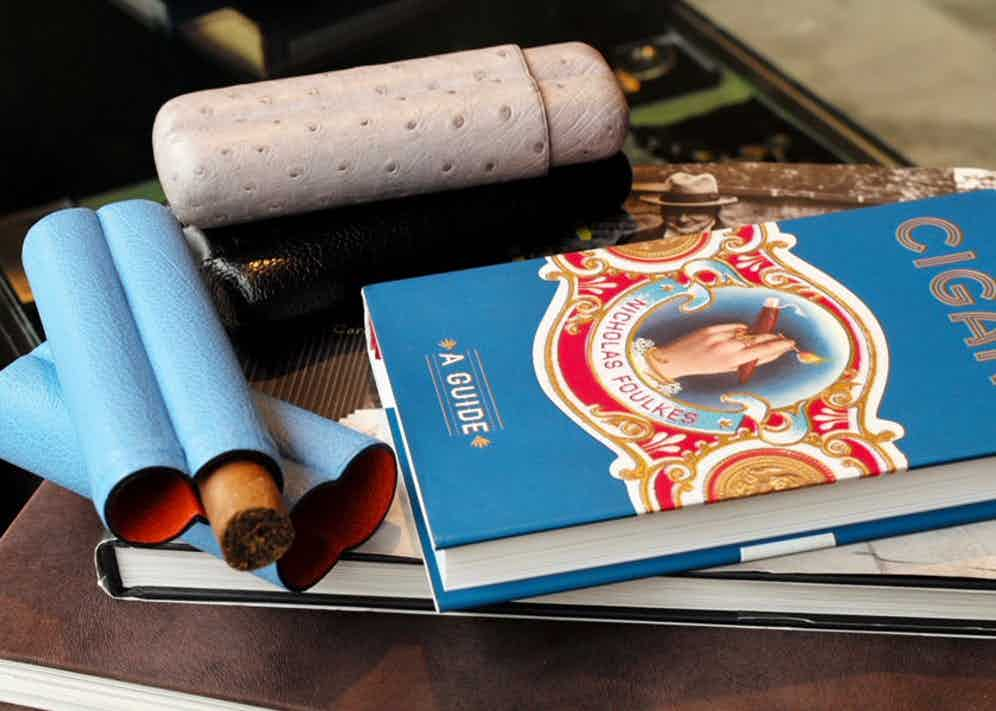 A vibrant two-cigar holder made from blue buffalo leather. Photo by Justin Hast.