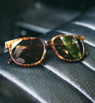 Ray-Ban was founded by Bausch & Lomb, which used to manufacture its eyewear in the city of Rochester, New York, which is also Benjamin's hometown. These vintage tortoiseshell frames are from the early eighties, before the company was sold.