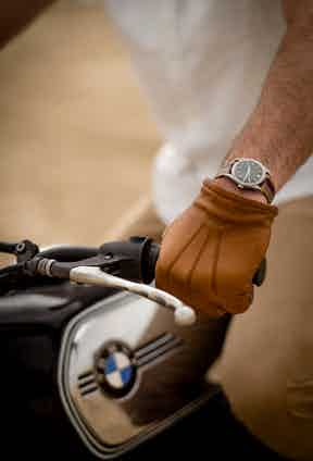 Tan leather gloves perfectly complement the BMW.