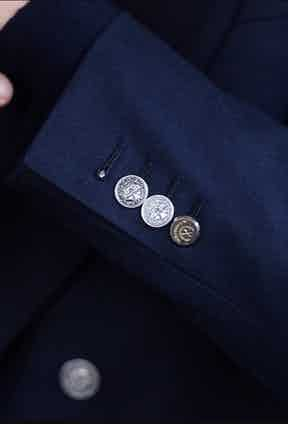 Caraceni's signature silver buttons. Photo by Ben Harries.