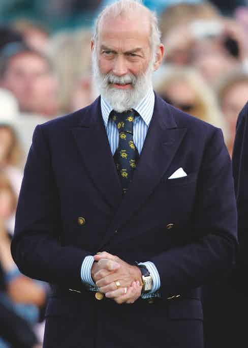 Prince Michael of Kent opts for a similar blazer yet with a 6x2 configuration that perfectly complements his broad frame.