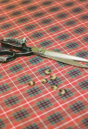 Baracuta's signature tartan fabric on the cutting table.