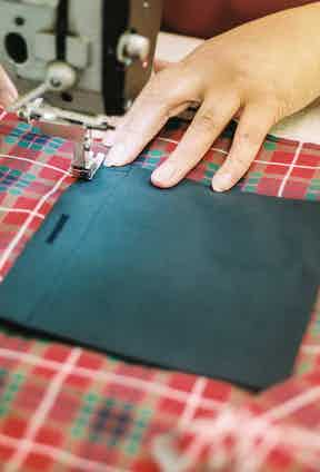 The interior pocket of a G9 being sewn in.