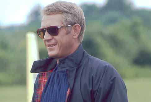 McQueen sporting the classic Harrington jacket in The Thomas Crown Affair, 1968, with a pair of Persol sunglasses.