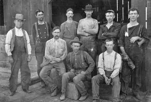 Miners wearing 'denim overalls' in western American, circa 1900s.