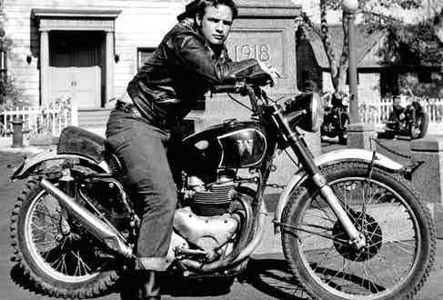 Marlon Brando on the set of The Wild One in 1953, wearing jeans and a leather jacket.