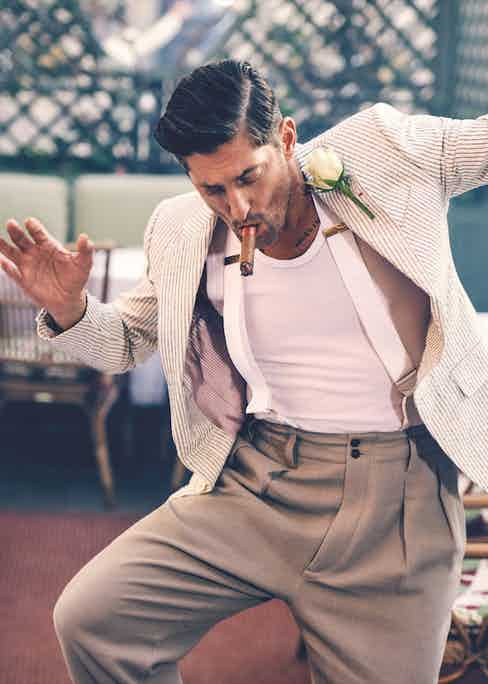 Tony Ward wears ivory and navy striped cotton jacket, Caruso; white cotton vest, Hermès; beige cotton high-waisted, wide trousers, Giorgio Armani; white silk braces, Budd Shirtmakers. Originally published in Issue 50 of The Rake.