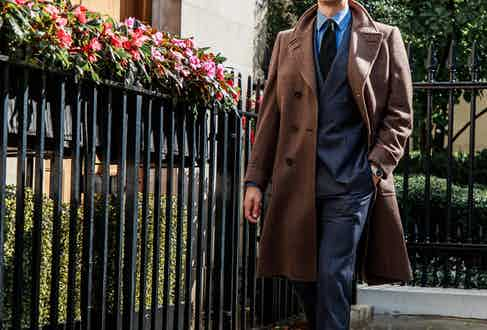 Chester Barrie's herringbone greatcoat paired with the denim Kingly suit.