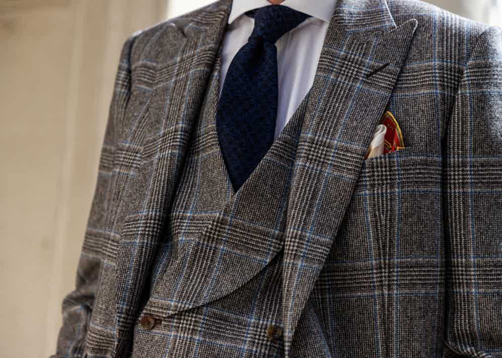 Chester Barrie's glen check suit is made with warm autumnal colours with a hint of teal.