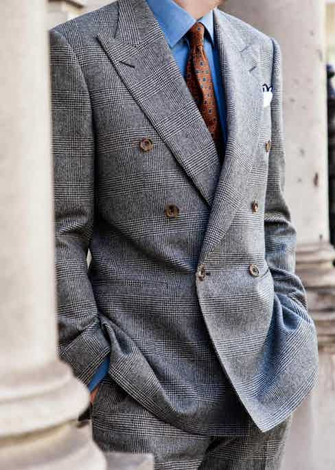 This Prince of Wales check suit pairs well with a denim or white shirt.
