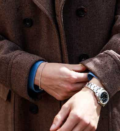 The Chester Barrie greatcoat is made with a brown herringbone weave.