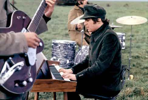 John Lennon in a corduroy suit and hat filming Help! on the Salisbury Plains, 1965. The Beatles were credited with saving the corduroy industry, as their music and style exploded onto the scene and cast such a wide net of appeal.