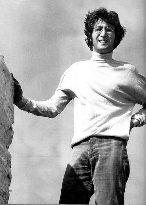 John Lennon takes a casual approach in a turtle-neck and corduroy trousers.