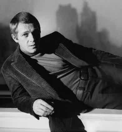 Steve McQueen pairs texture and tone in a corduroy jacket and a ribbed turtle neck.