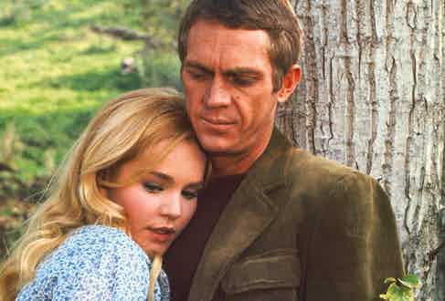 McQueen wears an olive corduroy jacket on set for Soldier in the Rain, with co-star Tuesday Weld, 1963.