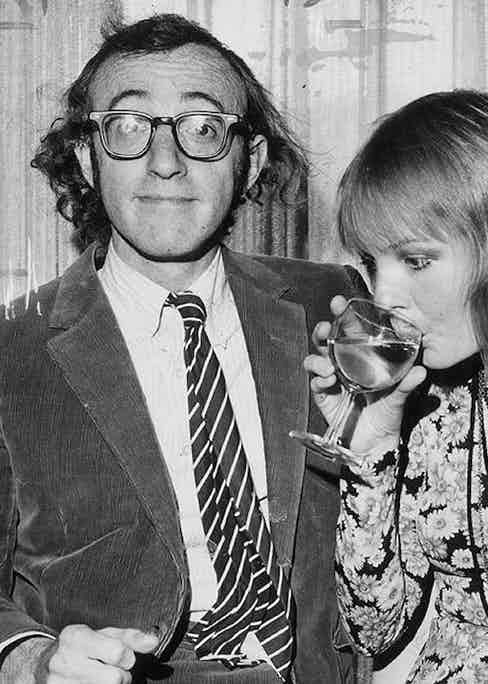 Director Woody Allen channels geek chic in a corduroy suit and thick-framed glasses, circa 1970.