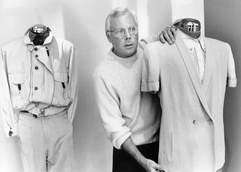 Giorgio stands between two of his designs in his studio in New York, 1989. Photo by John Minihan/ANL/REX/Shutterstock.
