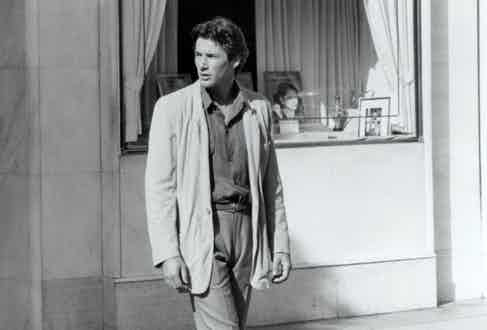 Armani dressed Gere in an unstructured, half-lined and longer-than-typical ventless linen jacket with a grey shirt and pleated grey trousers to create a sultry and casual appearance, 1980.