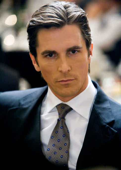 Christian Bale was dressed by Armani to play the role of Bruce Wayne in Batman: The Dark Knight, 2008. Photo by AF archive/Alamy.