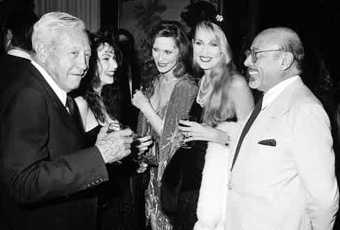 With Rosie Hall, Cindy Hall, Jerry Hall and Ahmet Ertegun at Diana Vreeland's book party at Mortimer's restaurant in New York, 1984. Photo by Ron Galella/WireImage.