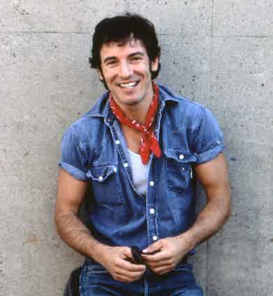 Only Bruce could pull off the rock 'n' roll cliche of double denim so effortlessly, as he poses for a portrait before performing at the Philadelphia Spectrum, 1984. Photograph by David Gahr/Getty Images.
