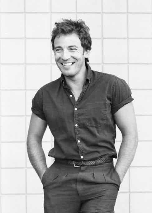 Springsteen's style was simple and relaxed as seen here wearing pleated trousers and a short sleeve shirt.