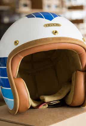 A bespoke Hedon motorcycle helmet will be offered as gift in the charity auction. Pictured is the Hedon x The Rake Apollo helmet.