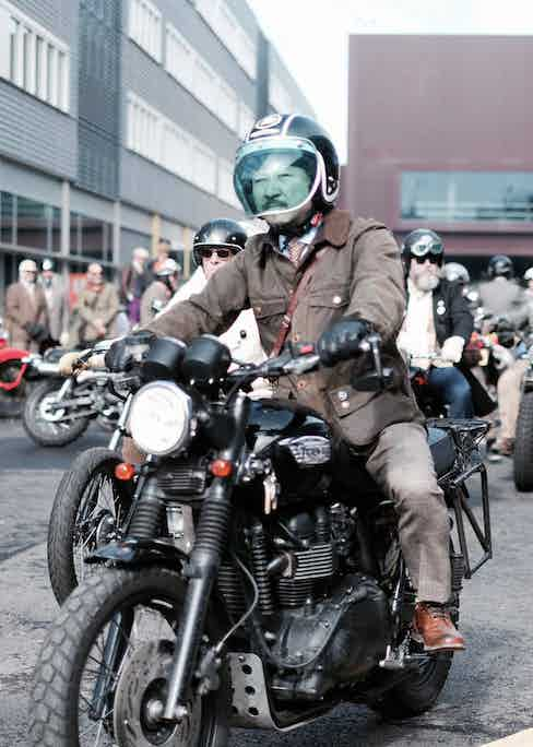 A rider on his Triumph Bonneville motorcycle at the DGR in London, 2016. Photograph by Justin Hast.