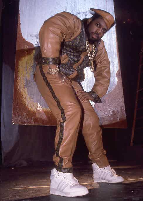 Jam Master Jay from hip-hop group Run DMC in the iconic Louis Vuitton matching tracksuit, circa 1988.