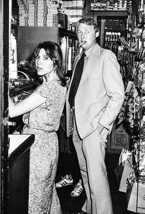 Actress Carrie Fisher and Mike Nichols helping themselves to a drink behind the bar at Elaine's, 1978. Photo by Ron Galella.