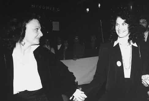 Fashion designer Diane Von Furstenberg and motion picture producer Sherry Lansing holding hands at the 25th anniversary party of Elaine's restaurant. Photo by Robin Platzer/Twin Images/The LIFE Images Collection/Getty Images.