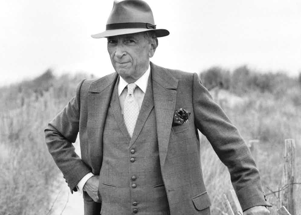 Talese wearing a three-piece single-breasted suit accessorised with a spotted silk pocket square and fedora, circa 2010.