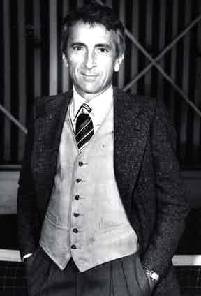 Talese appears effortlessly sophisticated in a single-breasted wool jacket, vest and striped silk tie, circa 1975.