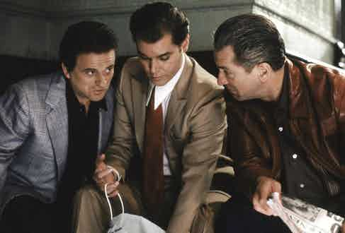 Joe Pesci, Ray Liotta and Robert De Niro embody the style of the time with generous drape cut suits, structured shoulders, wide ties and slicked back hair. De Niro is thought to have had a matching watch and signet ring combination for every outfit.