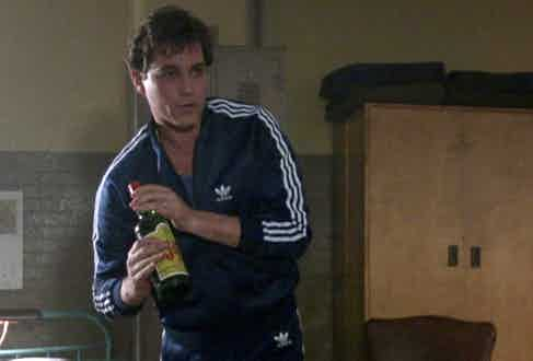 Even in jail, Hill and his associates manage to maintain a level of style. While the older gentlemen don silk jacquard bathrobes and smoke cigars, Henry Hill's Adidas tracksuit signify his younger, more energetic and street-savvy approach.