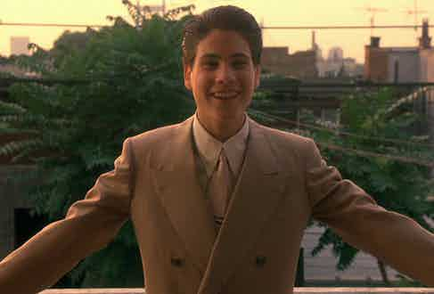 Henry Hill as a young man, played by Christopher Serrone, wears a double-breasted peaked lapel suit, spearpoint collar shirt and pale pink silk tie.