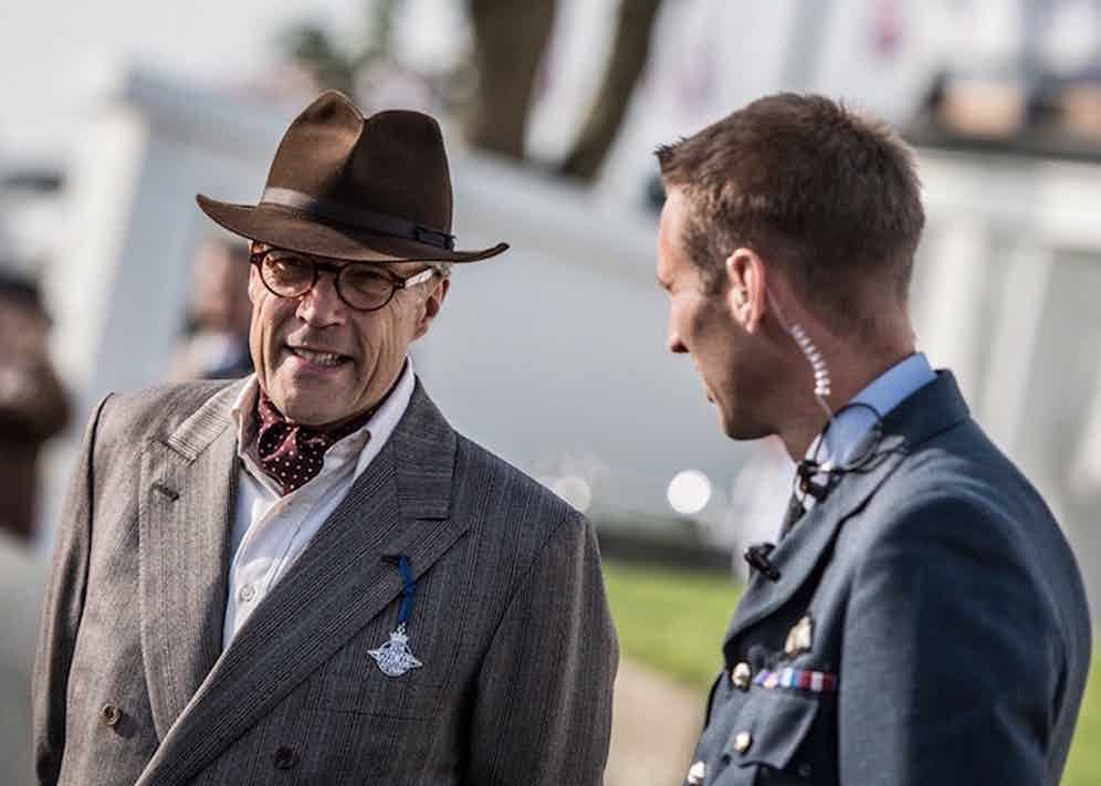 Lord March, owner of Goodwood Estate, wears a 'racing felt' and a double-breasted grey jacket with a silk maroon cravat at Goodwood Revival, 2016.