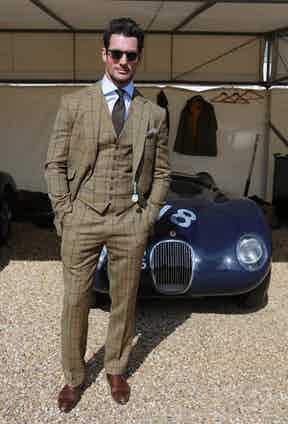 David Gandy dons a three-piece windowpane suit paired with a silk pocket square, vintage-inspired sunglasses and brown leather Oxford brogues at Goodwood Revival, 2017.